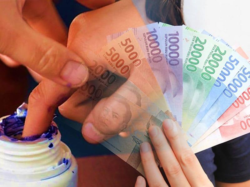 Tukar Uang Pecahan Baru di BI Kediri, Warga Harus Celupkan Jari ke Tinta